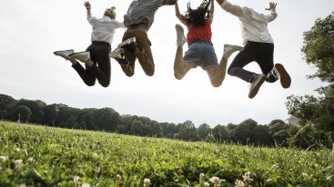 Young adults jumping