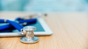 Stethoscope laying on a tablet device