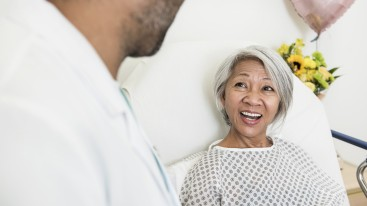 Smiling patient with healthcare professional